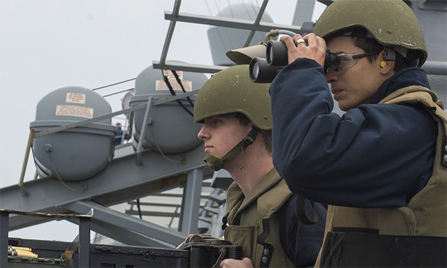 Crewmen with binocculars