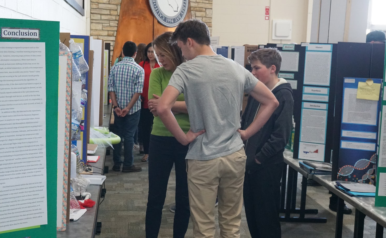 Attendees viewing Science Fair posters